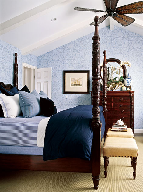 Colonial-style-interior-bedroom-decorated-with-dark-wood-spindle-bed-with-convinient-matress-blue-wallpapers-mirror-and-dresser